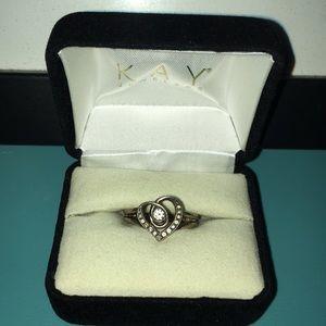 1/10 CT. T.W. Diamond Heart Twist Sterling Silver